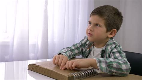 blind child boy reading braille stock footage video