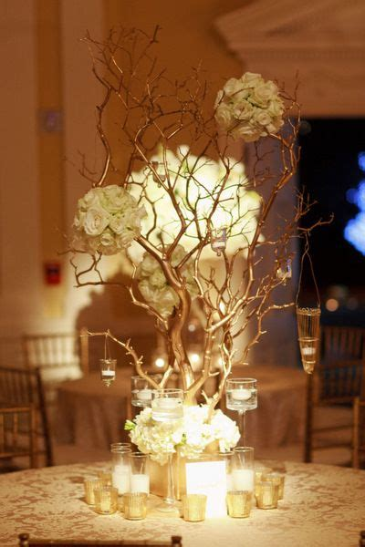 white tree with gold decorations gold white and candles manzanita centerpieces