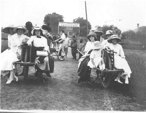 Group Of Foreign Ladies On Chinese Wheelbarrows