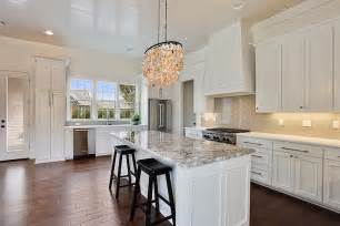 white kitchen island with gray granite countertops transitional kitchen