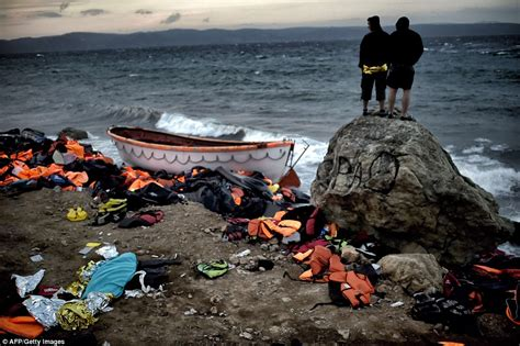 Refugee Boat Lands On Spanish Beach by Refugee Bodies Wash Up On Lesbos Including Children After