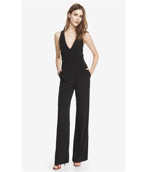 express jumpsuits lyst express wide leg halter jumpsuit in black