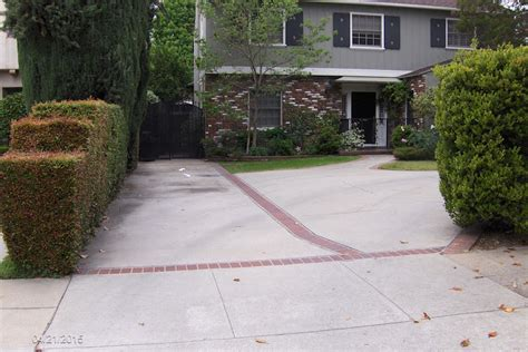 paved driveway cost driveway paving comparing asphalt vs brick vs concrete