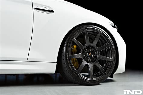 alpine white bmw  upgraded  carbon fiber wheels