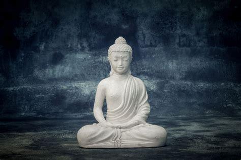 sitting juvenile buddha meditating stone work asia