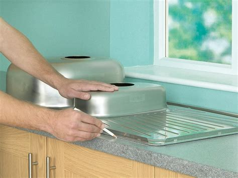 cutting out sink laminate countertop how to install a kitchen sink in a laminate or wood