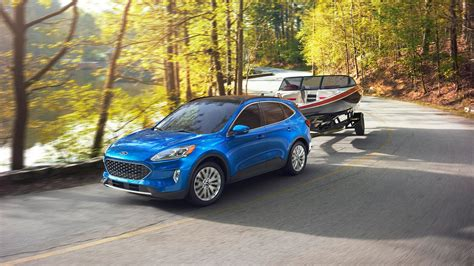 A ford escape sel hybrid, with the same powertrain, costs $30,200 with fwd and $31,700 with the new ford escape phev is available in se, sel, and titanium trims. 2020 Ford Escape Hybrid First Drive Review: The Sweet Spot ...