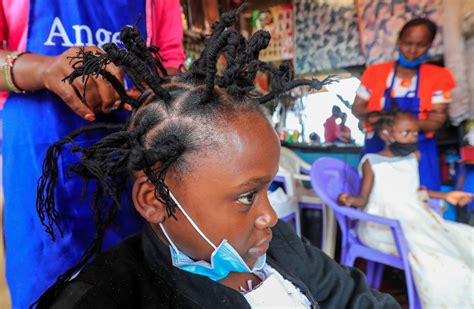 nairobi hair salon defies pandemic  coronavirus style reuters