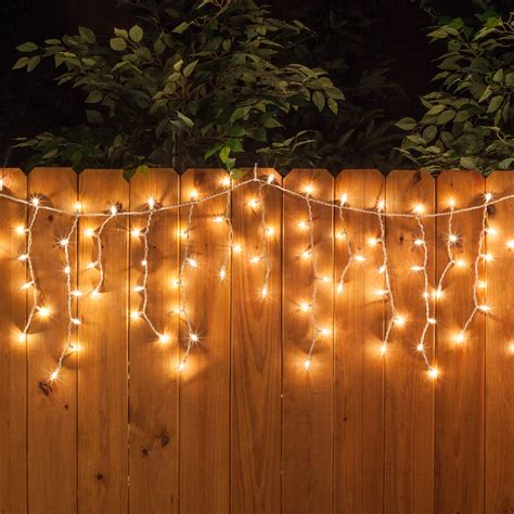 how to hang string lights on fence 150 icicle lights clear twinkle white wire yard envy