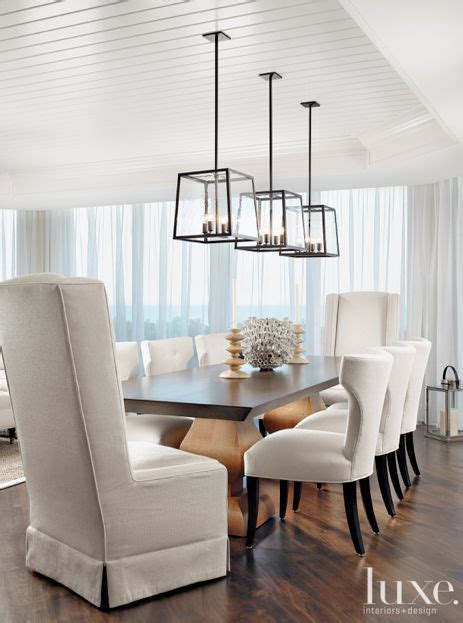 over dining table lighting in this stunning dining room three holly hunt light