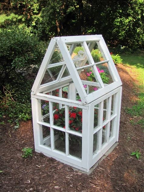 This simple indoor greenhouse is right for a small space, it's built of wood and there are some containers for growing. 6 old windows are combined to assemble this easy, low-cost ...