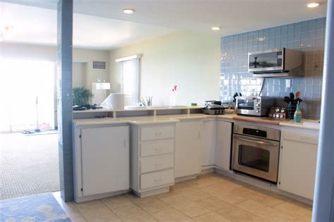 hang microwave without cabinet above the aruba kitchen plan