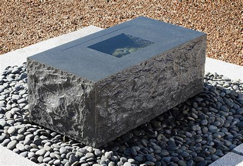granite fountains from forest landscape