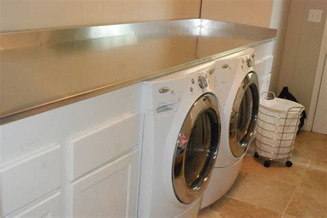 washer and dryer countertop stainless steel countertops transitional laundry room