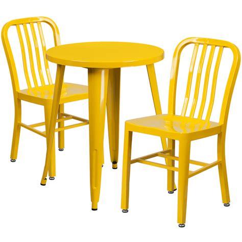 24 yellow metal indoor outdoor table set with 2