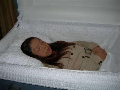 Beautiful women in their caskets. Beautiful Girls in Their Coffins