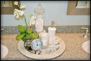 placing a few accessories on a tray can give a bathroom With spa like bathroom accessories