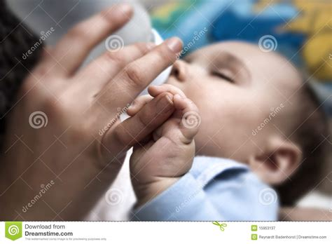 Baby Holding Mothers Finger Royalty Free Stock Photography