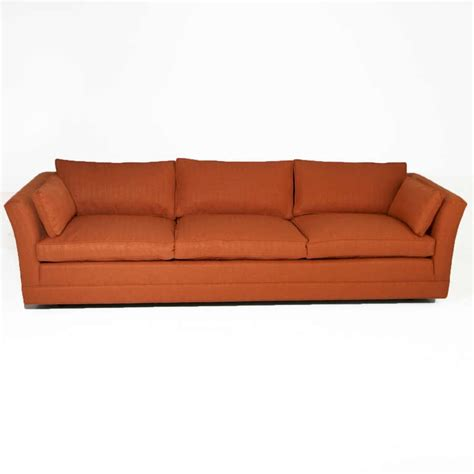 comfortable vintage sofa   filled cushions   manner  dunbar  stdibs