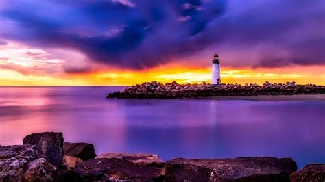 ocean bay beach sunset lighthouse scenery preview