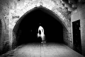 A Rabbi disappears through a tunnel in the Old City in ...