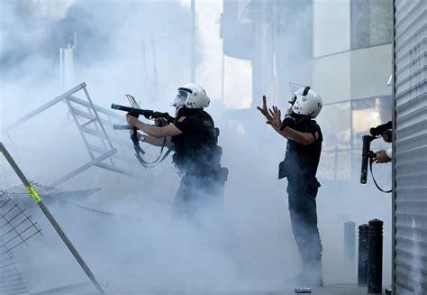 police crush barricades  istanbuls taksim square