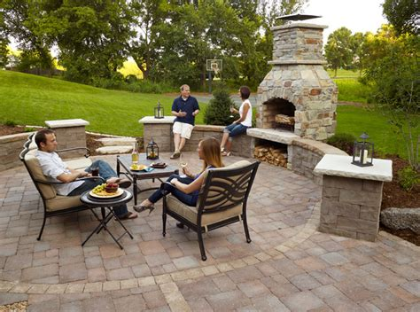 outdoor fireplace paver patio with seat wall and