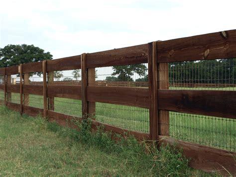 wooden fence gates styles ranch style wood fence designs ranch style fencing titan fence driveway gates pinterest