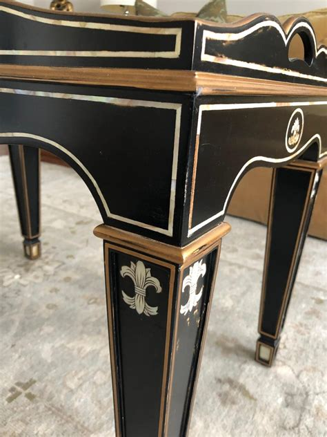 Tray table side coffee table furniture living room black top gold metal frame. Gem of a Hollywood Regency Black White and Gold Small Sized Tray Coffee Table For Sale at 1stdibs