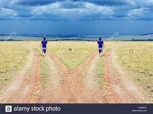 One young man walking down two different paths Stock Photo ...