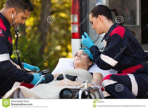 Emergency Medical Technicians Patients Stock Photo