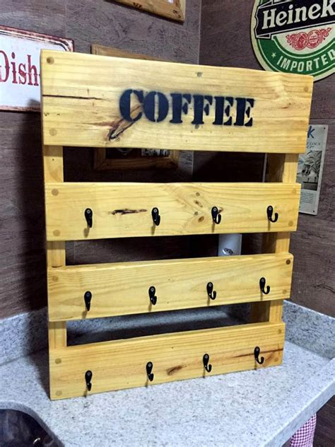 Our coffee mug shelf with hooks is super sturdy using our unique mounting point hardware reinforcement which is hallmark to our pieces helping prevent cantilever load stresses, cracking, or sagging. Wooden Pallet Coffee Mug Rack - Easy Pallet Ideas