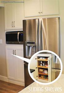 A built-in microwave is located in the center of a tall