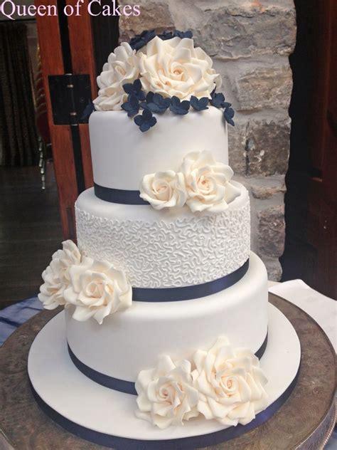 cornelli lace wedding cake  ivory sugar roses  navy