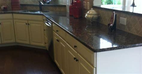 kitchen countertops with backsplash baltic brown granite butterscotch glaze cabinets 4324