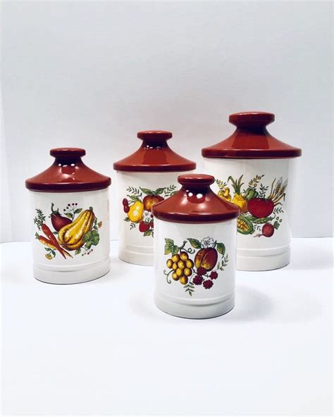 Three white ceramic canisters set in scrollwork holders give a touch of elegance to your kitchen. Vintage Canister Set - Set of 4 - Ceramic Canisters- Garden Harvest- Rust Red Lids- Kitchen ...