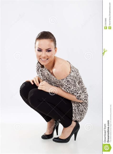 woman  squat position smiling stock image image