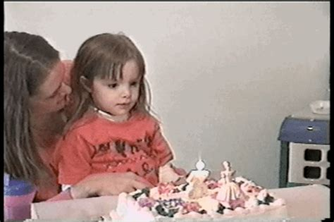apparently blowing  birthday cake candles