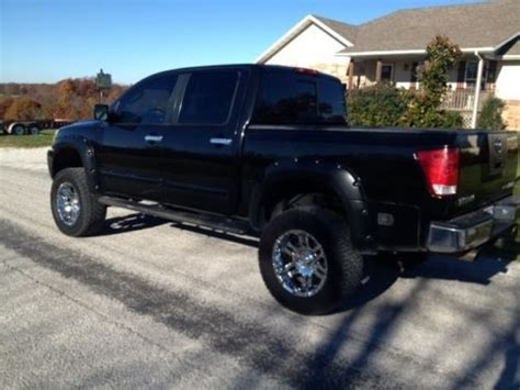 sell  nissan titan truck black  lift  tires