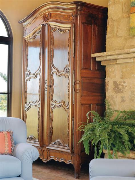 Armoire In Living Room Antique Armoire In Mediterranean Style Living Room