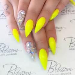 Yellow color nail art design : Yellow nail art design on long nails the matte finish