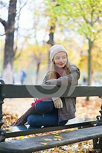 Sad Girl Sitting On A Bench In Park Stock Photo - Image ...