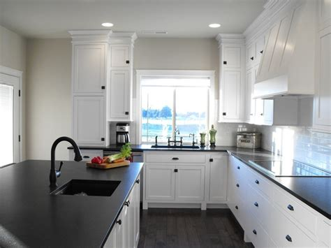 white cabinetry black counters greige walls black
