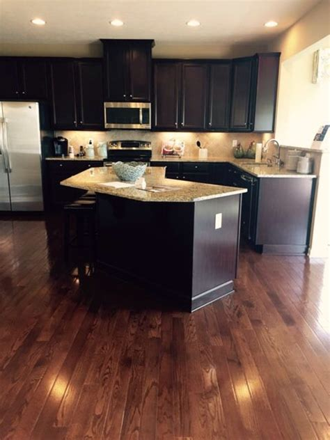 espresso kitchen cabinets with light floors homes espresso cabinets and saddle 3 1 4 quot hardwood