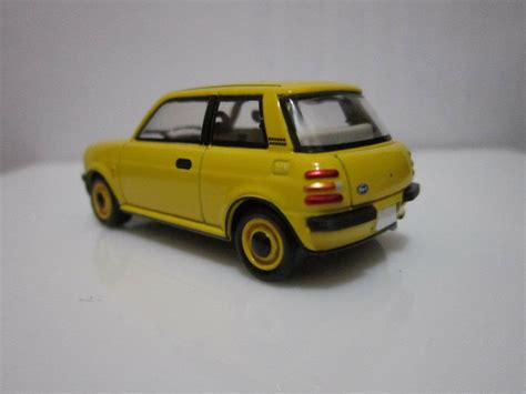 TLV N39a - Nissan Be-1 Yellow - ACP Mini Model Store