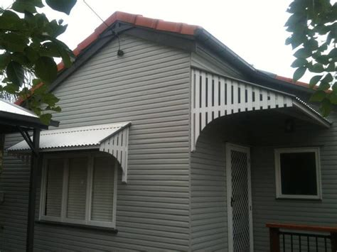 colonial  post war style window awnings carpentry