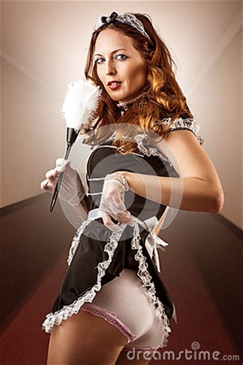 sexy french maid holding duster royalty  stock