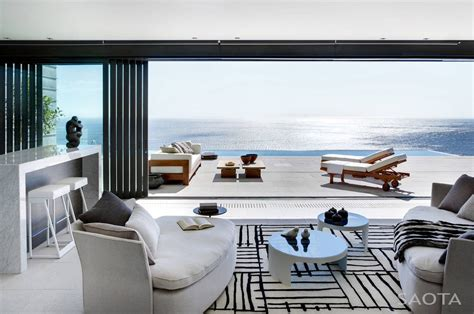 view interior of homes modern private residence with dramatic living room overlooking the ocean idesignarch