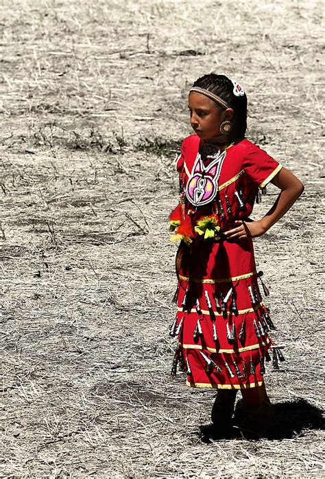 a native american girl in a traditional clothing during
