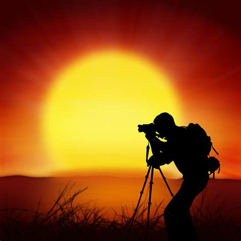 silhouette of photographer with big sun photograph by setsiri silapasuwanchai